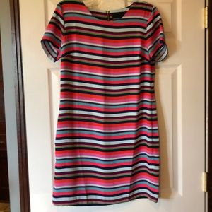 New with tags. Multi colored dress.  Sz. 8